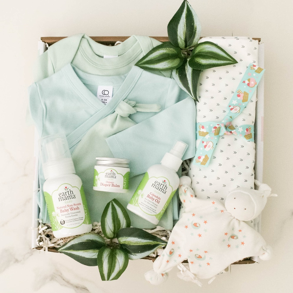 So Much Joy, Baby Boy gift basket contains a Classic Bodysuit, Under the Nile Baby Buddy, Natural Non-Scent Baby Wash, Calendula Baby Oil, Organic Diaper Balm, Swaddle Blanket,Classic Knotted hat,Classic Kimono Bodysuit