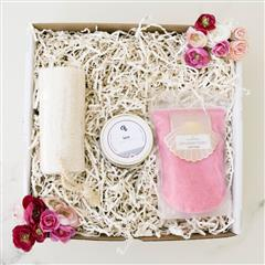 Simple Soak Gift box contains a zodiac candle, strawberry bubble pearl lux soak, natural loofah in our signature box