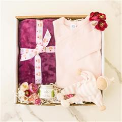 Pretty in pink, new baby girl essentials. Consist of warm and soft blanket,long sleeve kimono, size newborn and organic diaper balm