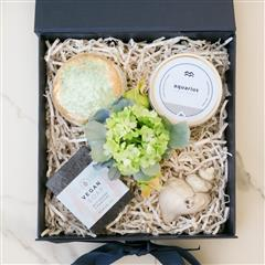 "This unique  box comes with a sterling silver shooting star charm and chain, ring bath bomb,aromatic zodiac candle and super cleansing, all natural, non-scented activated charcoal soap. Include a special ""I Love You Mom!"" message at the check out"