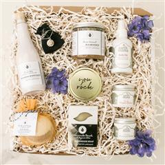New Mom's Lux Spa gift basket contains a Candle of Affection, Handmade Soap, Foaming Bath Salt, Bath Bomb, Pure Coconut Sugar Scrub, Organic Nipple Butter, Belly Oil, Organic Perineal Balm,Silver Charm with two Bronze Hearts