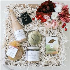 Season's Greetings gift box that contains a Candles of Affection, Pumkin Cake Soap, Fresh Brewed Coffee Sugar Scrub, Wildflowers with Chamomile Extract Foaming Bath Salt, Merry Mistletoe Bath Bomb,Shooting Star Silver Charm with Silver Chain, Small Flower Arrangment