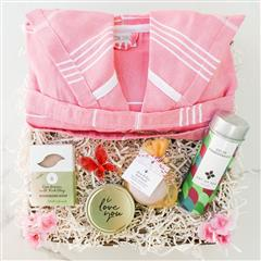 Pink Dreams gift basket contains a Candle of Affection,Green pomegranate tea from Art of Tea, Love Potion handmade Bath Bomb, Rose Dream All Natural Soap, Basic natural cotton Pestemal Bathrobe