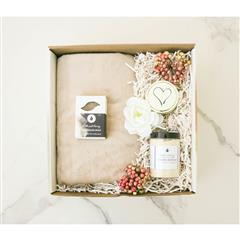 Best Feeling Spa gift basket that contains a Zodiac Candle, Foaming Bath Salt, Natural Loofah, Bunny Soft Throw Platinum in our signature box