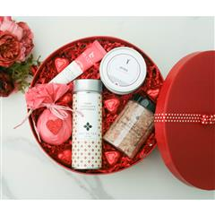our P. S I love  Valentine's naturally luxurious spa gift includes, cranberry vanilla dead sea bath soak, love potion bath bomb, chocolate cinnamon tea,zodiac candle, chocolate hearts, personalized note