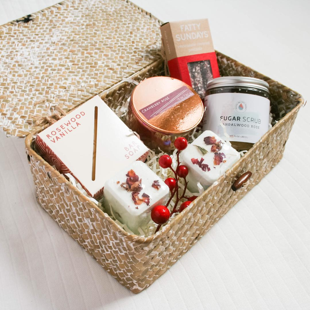 The Pamper Rose Gift Box comes with everything she needs to relax and enjoy some me time.Pamper Rose Gift Box Includes:Rosewood Vanilla Bar Soap,Sandalwood Rose Organic Sugar Scrub,Cranberry Rose Soy Candle,Rose Sangria Bath Bombs- set of two,Fatty Sundays Pretzels,White Wash Keepsake Box,Greeting Card,Satin Ribbon